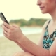 Young Happy Caucasian Woman Using Smartphone By the Sea. - VideoHive Item for Sale