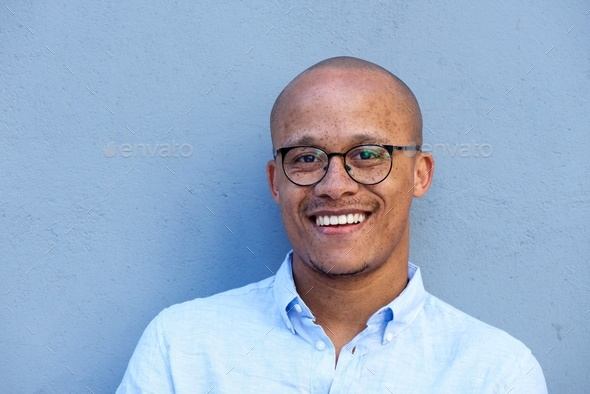 Close up smiling african american businessman with glasses - Stock Photo - Images
