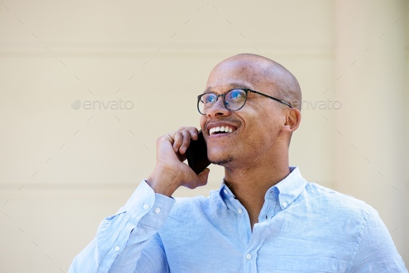 candid portrait of african businessman talking on cellphone - Stock Photo - Images