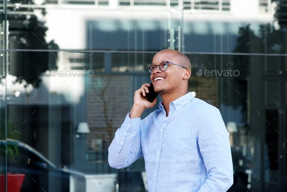 smiling businessman talking on cellphone - Stock Photo - Images