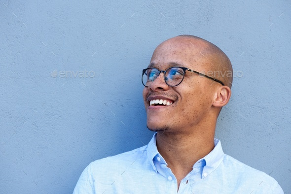 african businessman smiling with glasses - Stock Photo - Images