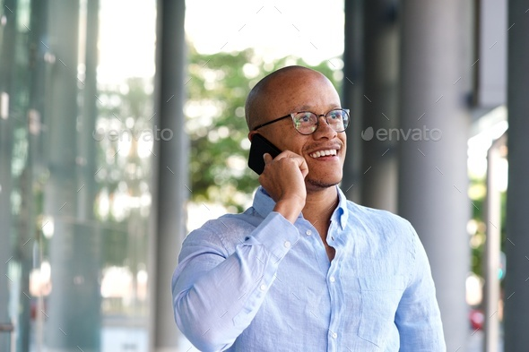 smiling businessman talking on mobile phone - Stock Photo - Images