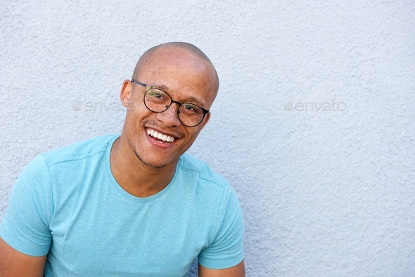 african man with glasses laughing - Stock Photo - Images