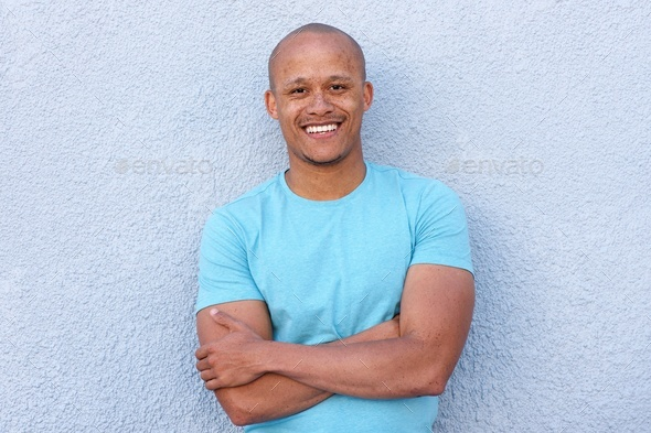 cool african american man smiling with arms crossed - Stock Photo - Images