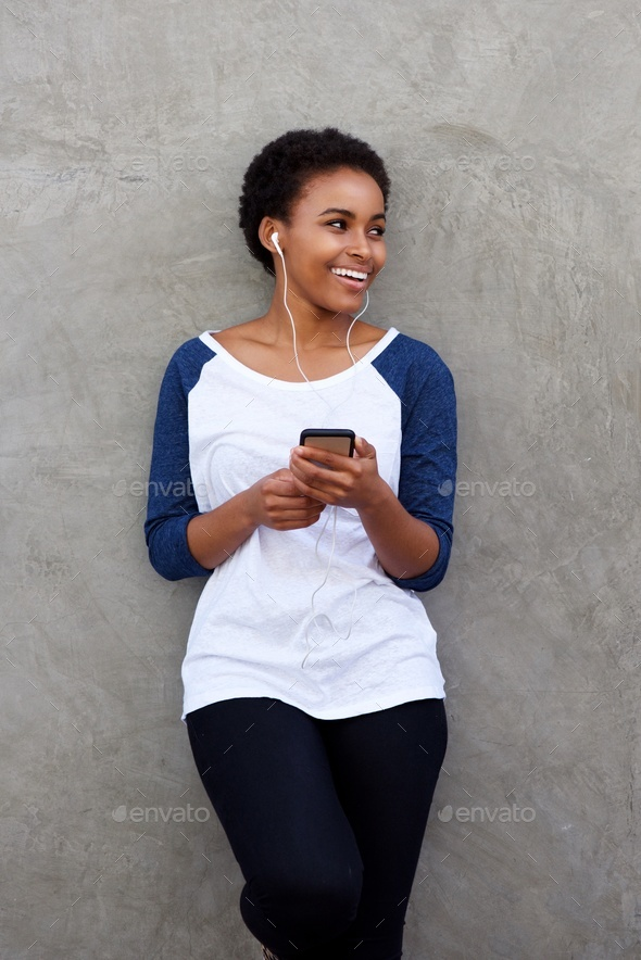 cool young black woman listening to music - Stock Photo - Images