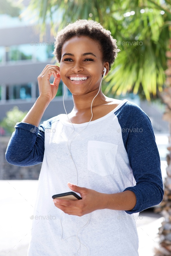 young woman listening rot music with earphones - Stock Photo - Images