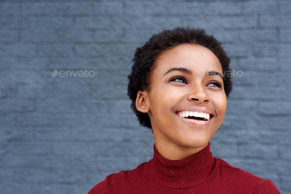 Close up happy young black woman laughing - Stock Photo - Images