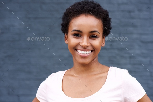 attractive young black woman smiling - Stock Photo - Images