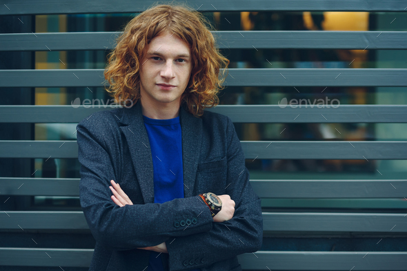 Curly man with crossed arms - Stock Photo - Images
