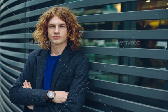Fashionable man portrait over urban futuristic background - Stock Photo - Images