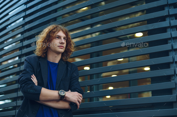 Model man with reddish curly hair - Stock Photo - Images