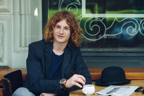 Portrait interesting reddish man posing with coffee - Stock Photo - Images