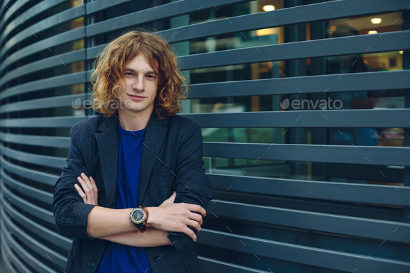 Portrait of red haired man over urban futuristic background - Stock Photo - Images