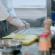 Male Cook Putting Floured Fish on a Tray - VideoHive Item for Sale