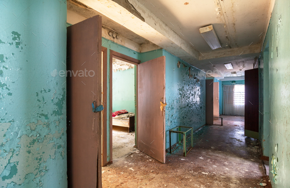 Corridor with open doors in an abandoned building - Stock Photo - Images