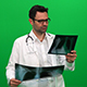 Doctor Analyzing X-Ray on Green Screen - VideoHive Item for Sale