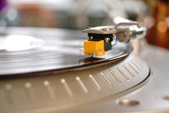 Big Yellow Turntable Needle Cartridge Stylus Transmits Sound  - Stock Photo - Images
