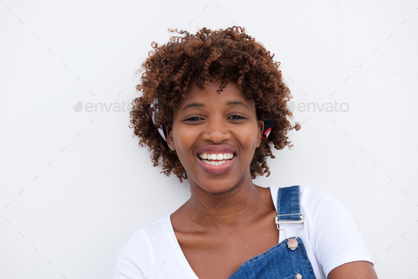 african woman smiling against isolated white background - Stock Photo - Images