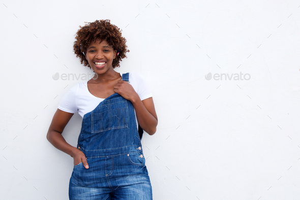 smiling african woman in overalls against white isolated background - Stock Photo - Images