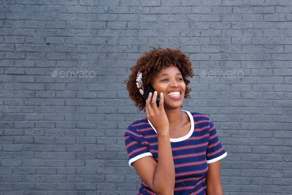 african woman talking on mobile phone - Stock Photo - Images