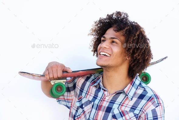 smiling guy with skateboard on isolated white background - Stock Photo - Images