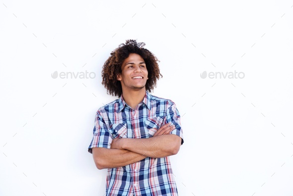 smiling young man standing against isolated white background - Stock Photo - Images