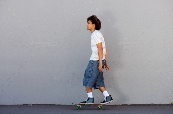 young man skateboarding outside - Stock Photo - Images