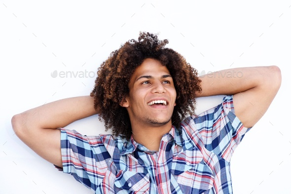 laughing young man with hands behind head - Stock Photo - Images
