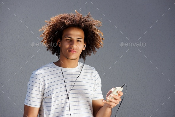 young afro man with earphones and cellphone - Stock Photo - Images
