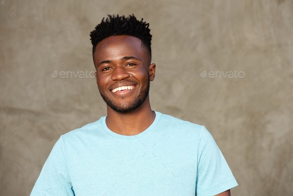 Close up handsome young african american man smiling - Stock Photo - Images