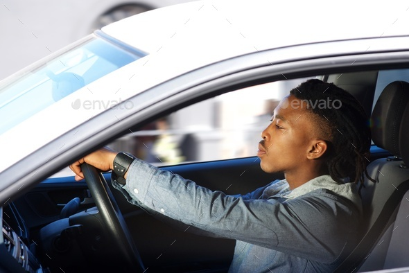young black man driving car - Stock Photo - Images