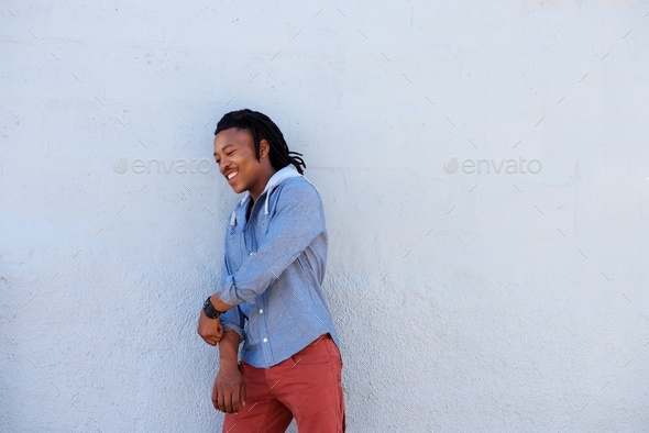 african man with dreadlocks smiling against gray background - Stock Photo - Images