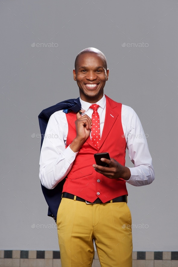 african american  business man smiling with cell phone - Stock Photo - Images