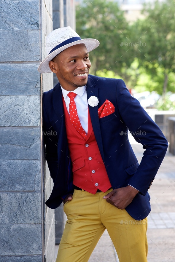 stylish young african american man in suit and hat - Stock Photo - Images