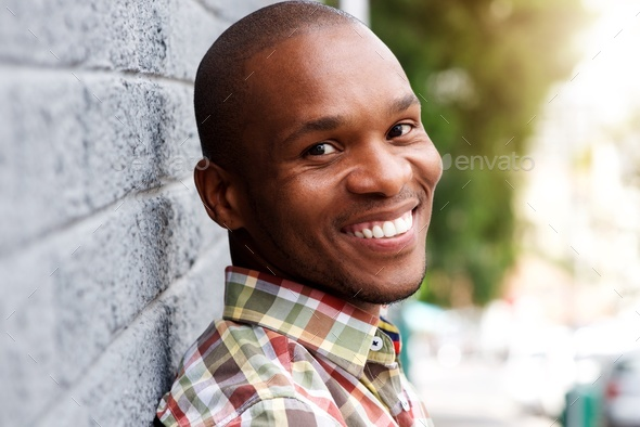handsome young african man smiling - Stock Photo - Images