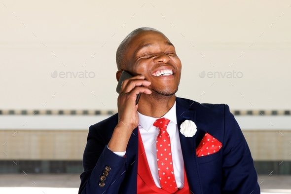 cheerful african businessman man talking on mobile phone - Stock Photo - Images