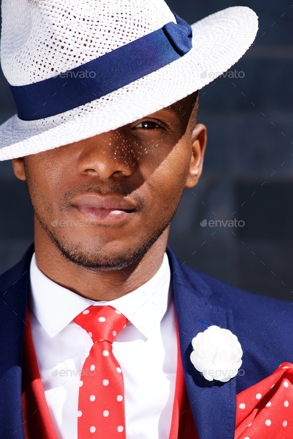 handsome young african businessman in hat - Stock Photo - Images