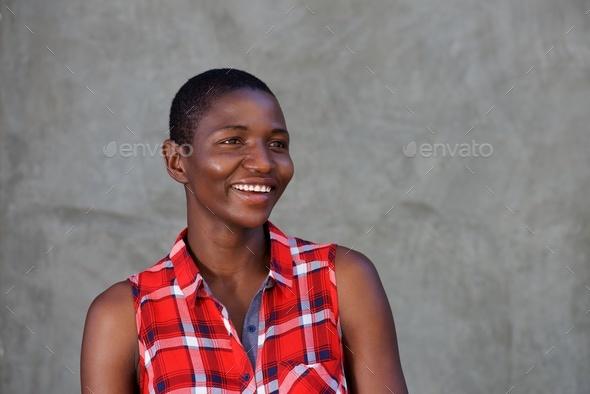 smiling beautiful woman wearing plaid shirt - Stock Photo - Images
