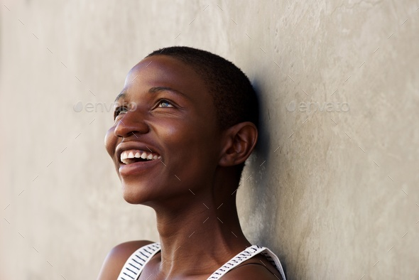 Close up portrait of beautiful black woman laughing - Stock Photo - Images