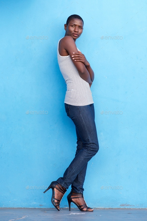 tall african fashion model standing with tank top and jeans - Stock Photo - Images