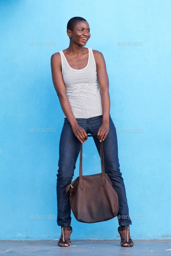 tall beautiful fashion woman smiling with bag - Stock Photo - Images