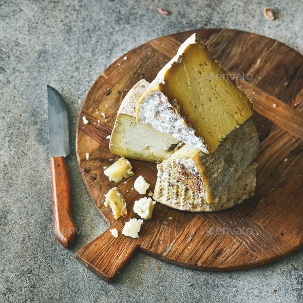 Cheese assortment on board, close-up, vertical composition - Stock Photo - Images