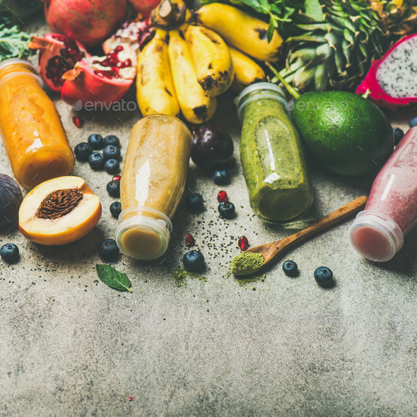 Colorful smoothies in bottles with fresh tropical fruit, square crop - Stock Photo - Images