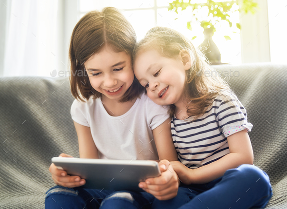 children are playing with tablet - Stock Photo - Images
