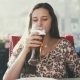 Attractive Woman Is Drinking Beer in a Bar. - VideoHive Item for Sale