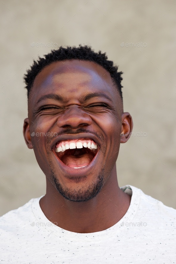 laughing young african american man - Stock Photo - Images