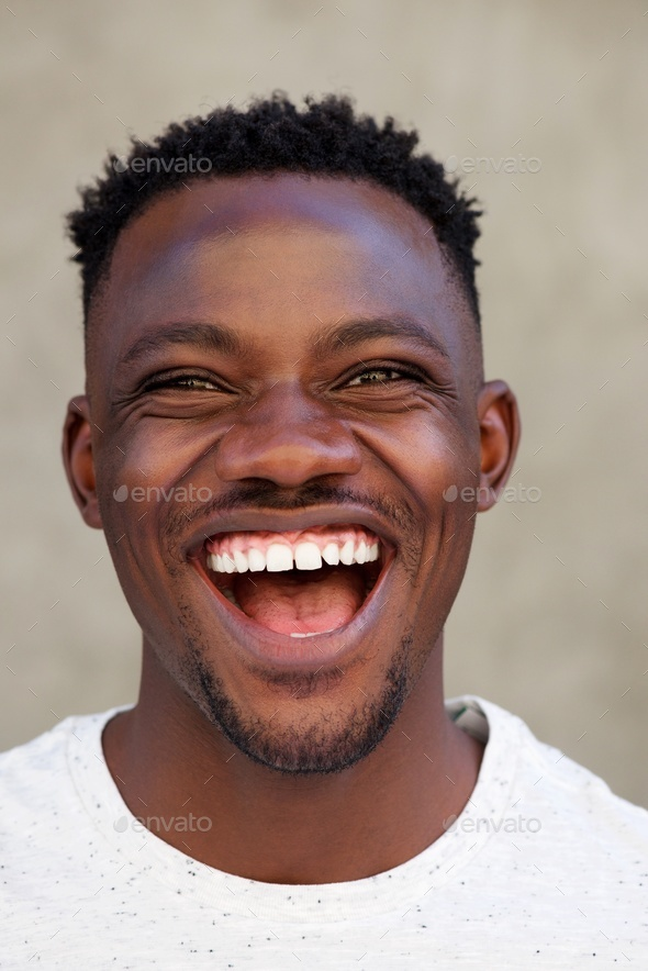 Cool young african american man laughing - Stock Photo - Images