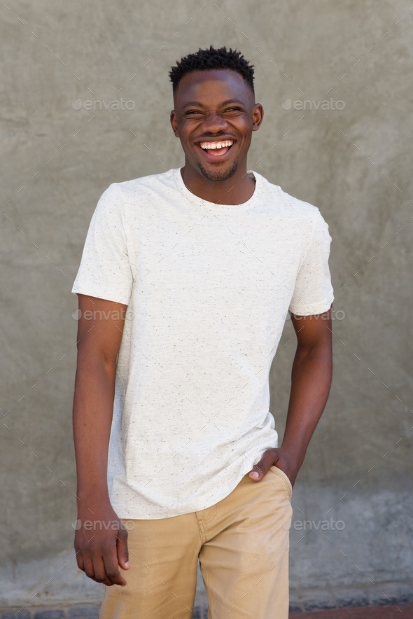 smiling young african american guy walking outside - Stock Photo - Images