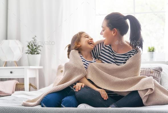Family playing under blanket - Stock Photo - Images