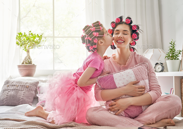 Mom and child doing hair - Stock Photo - Images